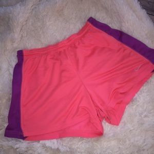 Nike bright pink and purple running track shorts